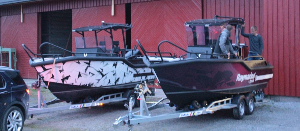 Two AluVenture 6500 CC boats on trailers